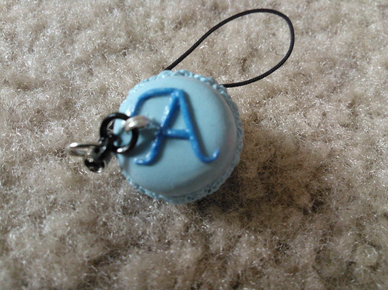 Polymer clay macaroon cell phone charm.