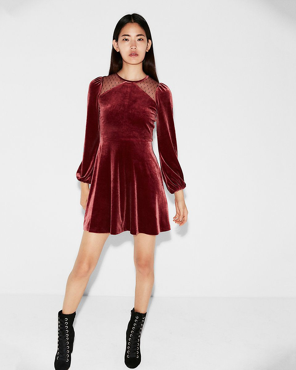This flared dress turns up the flirt with mesh inset shoulders all