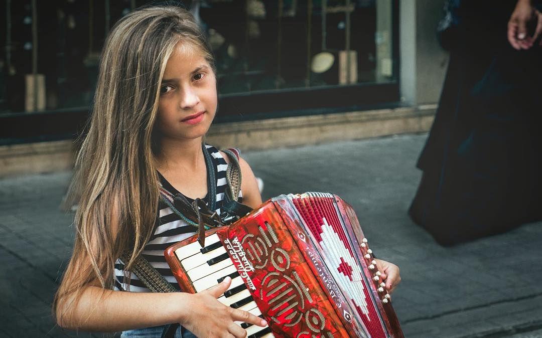 Little Istiklal Caddesi musician. #Turkey #turkeyphotooftheday #istanbul #lovefromturkey #istiklal #istiklalcaddesi #streetphotography #humans #portraitphotography #streetmusic #travel #travelphotography by grantmccallphotography