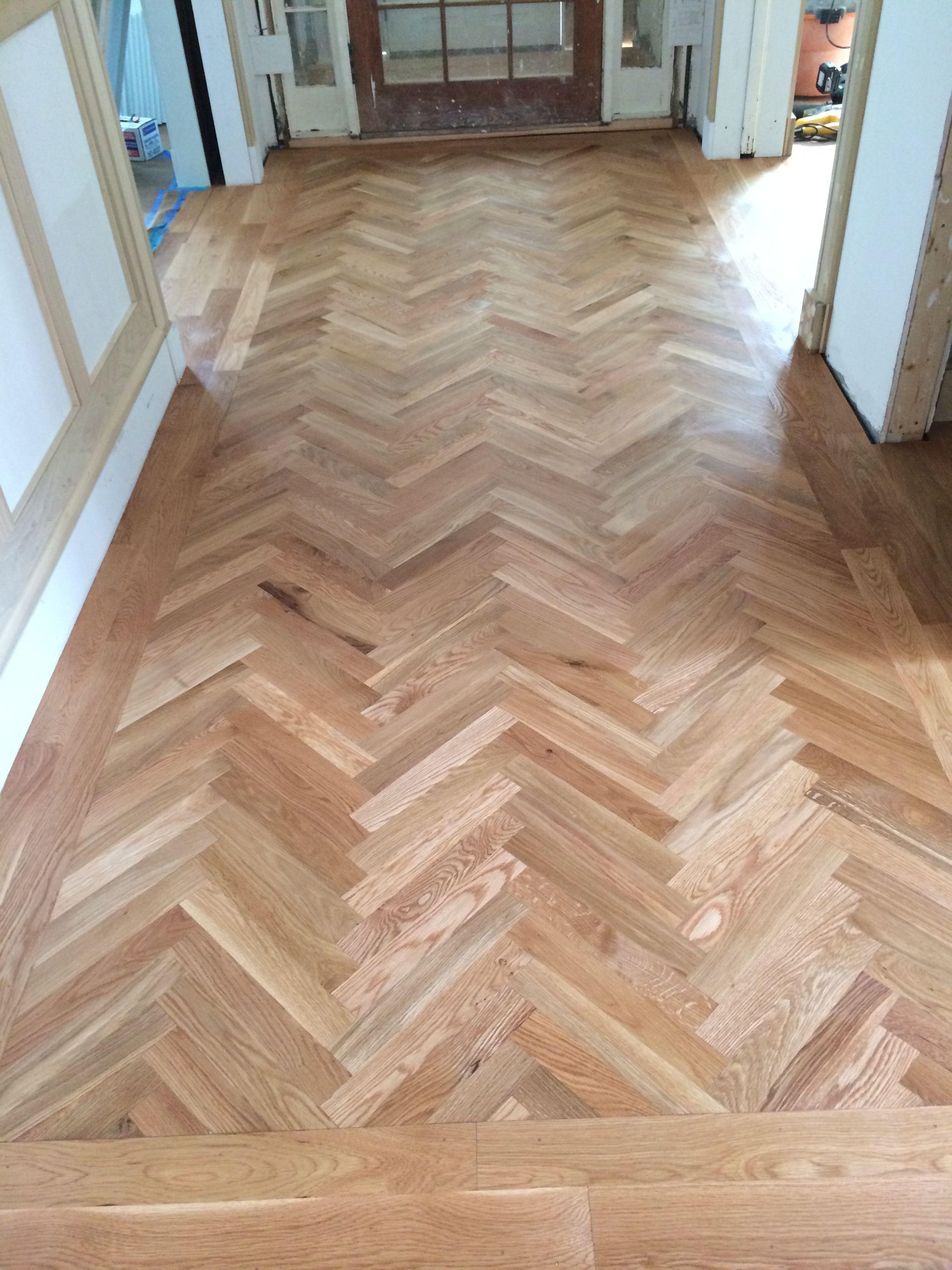 "2 1/4"" white oak hardwood flooring in a herring bone"