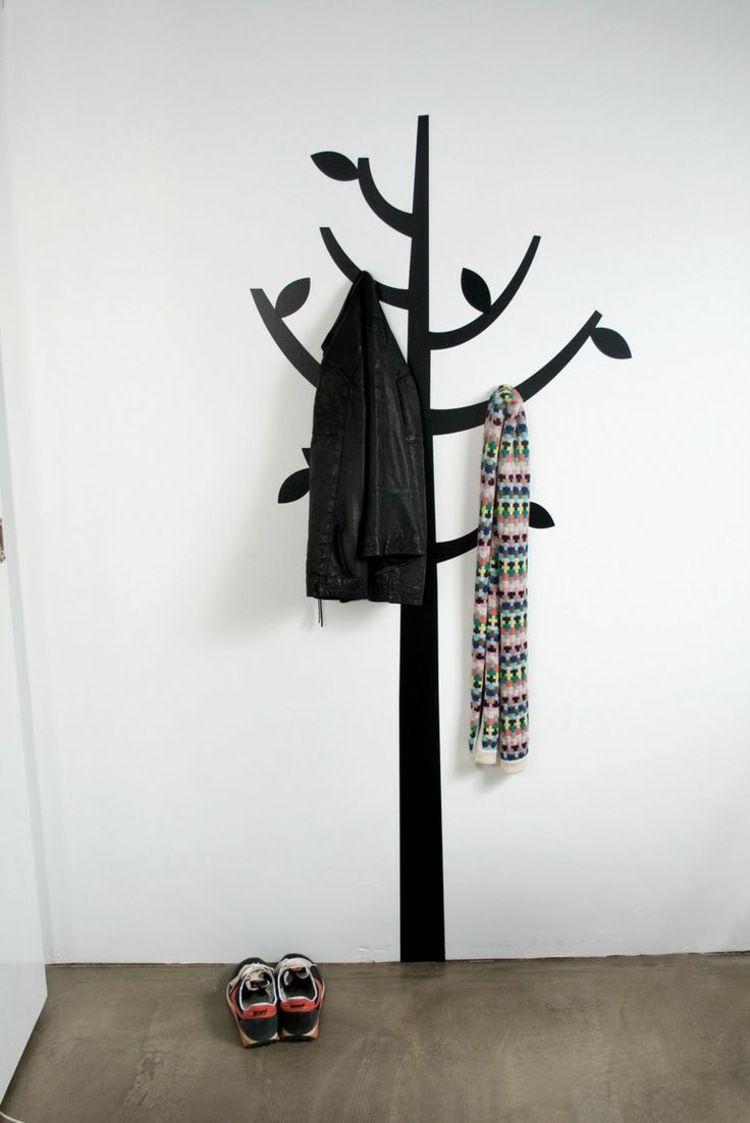 ideen für garderobe - ein schwarzer baum an einer weißen wand ... - Garderobe Ideen