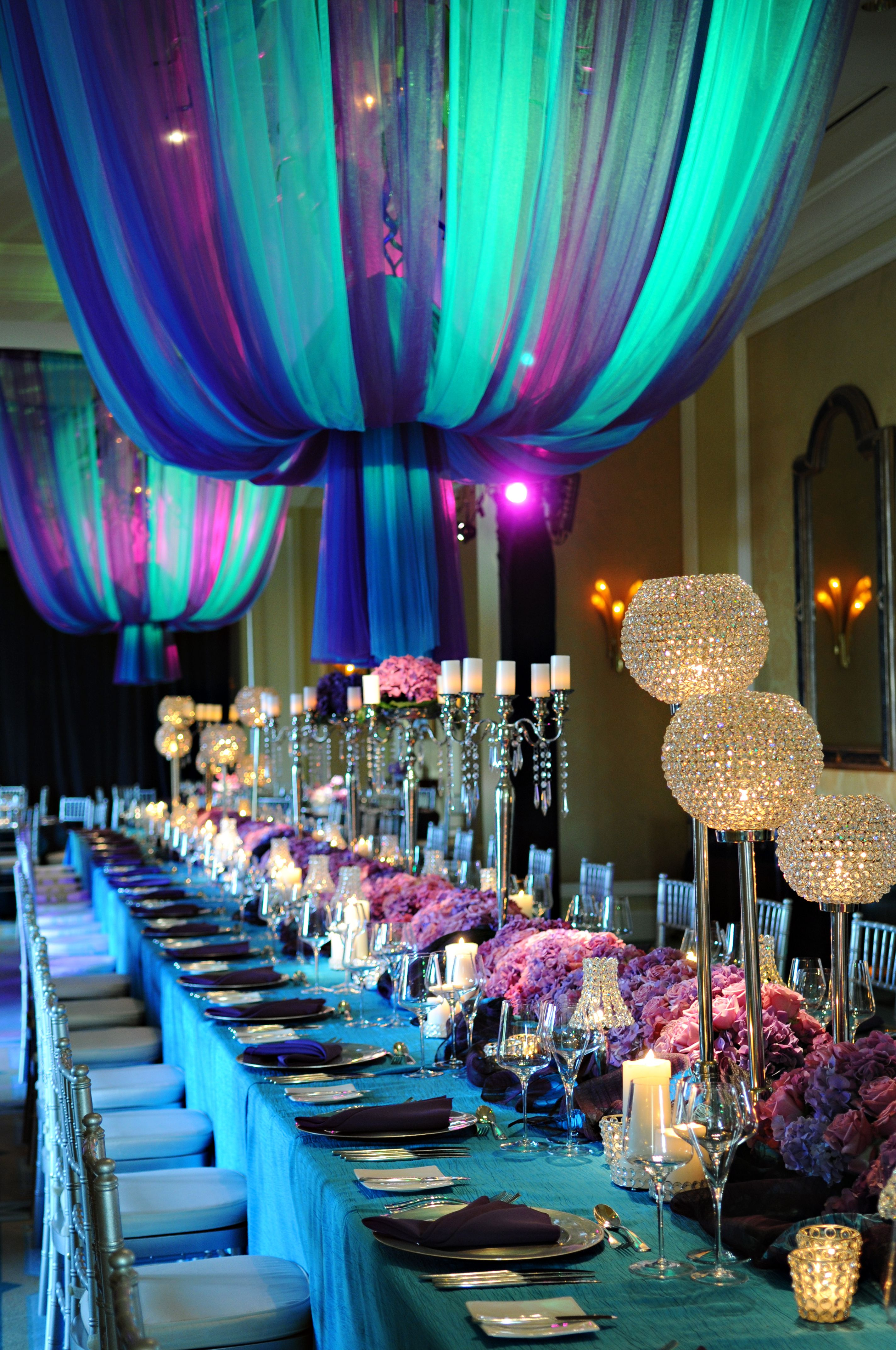 Dramatic hues of blue and purple creates a very sophisticated reception.