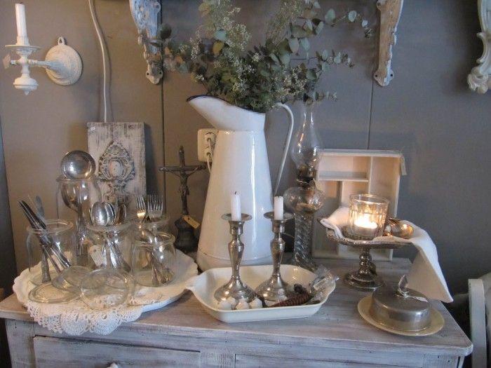 Sfeervol gedekte tafel mooie kaarsenstandaards zilveren for Decoratie spullen