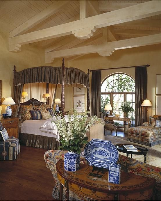 This Exquisite Master Bedroom Is Enhanced By Wood Vaulted