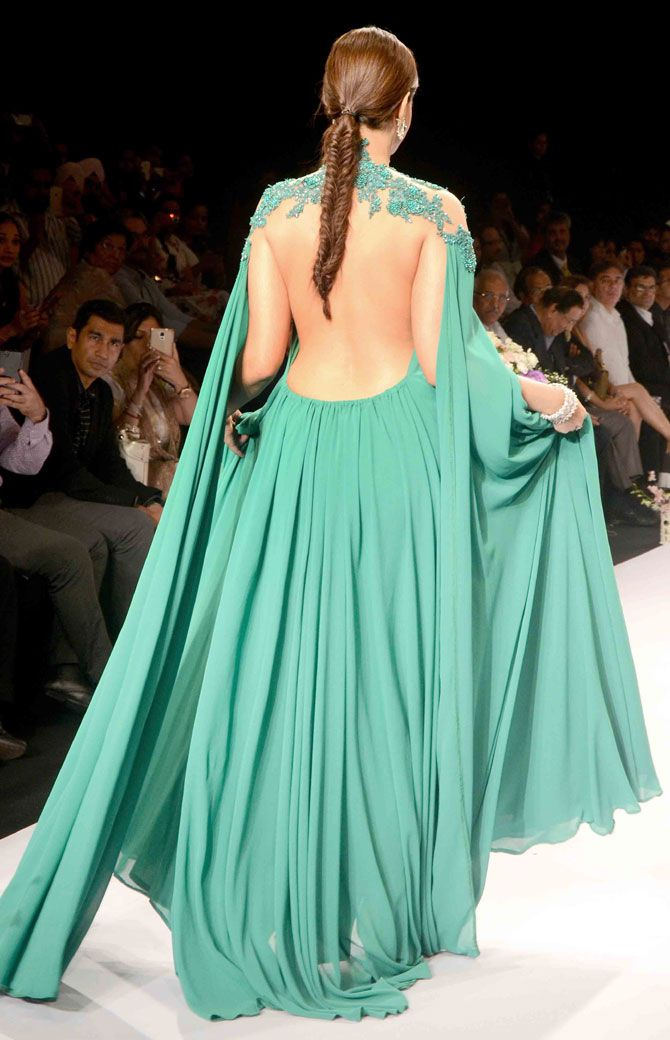Sonam Kapoor flaunted a backless gown and sported a fishtail braid on the ramp