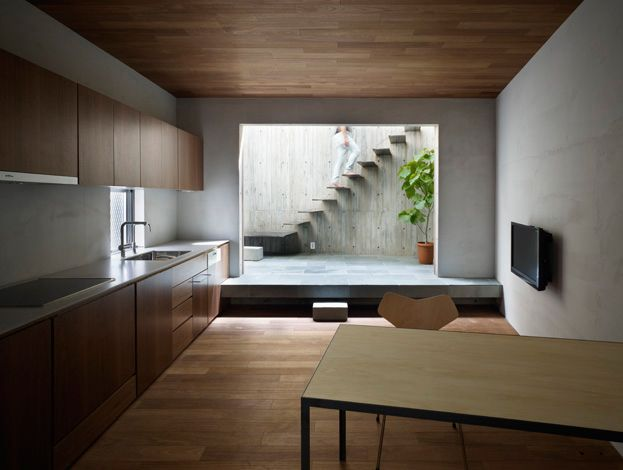 timber, smooth concrete, floating stairs in the background