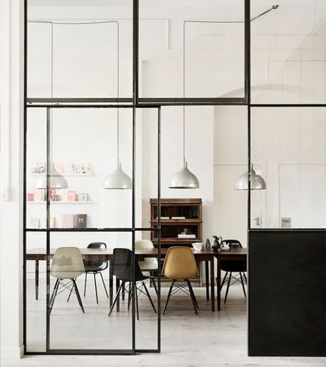 This Square Steel Framed Glass Wall Included A Sliding Door. Really  Effective Way To Divide Two Spaces