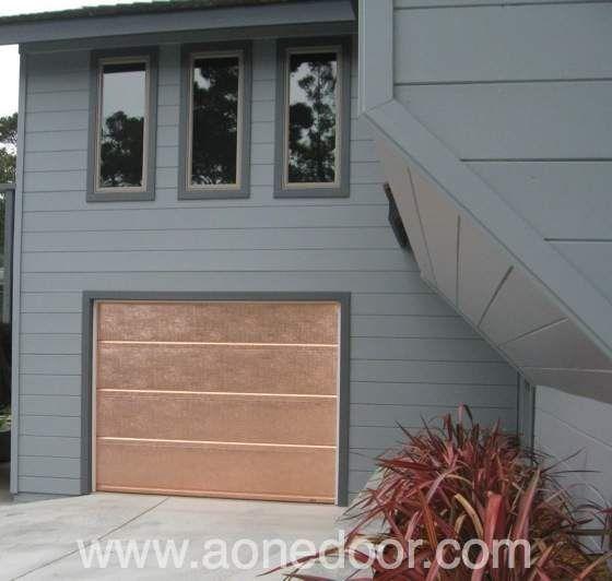 Custom Copper Covered Roll Up Garage Door By A 1 Overhead Door Company In Santa Cruz Http Www Aonedoor C Overhead Door Garage Door Installation Garage Doors