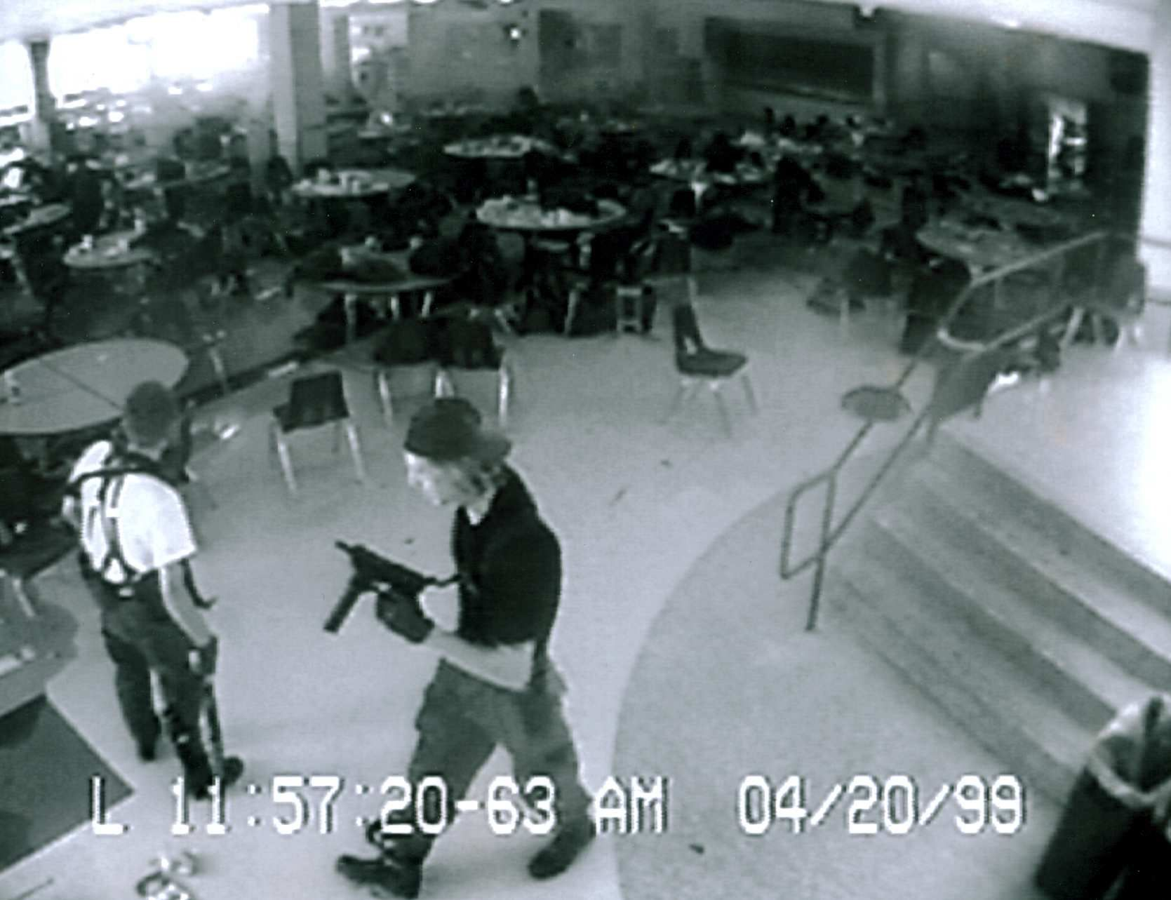 Eric Harris and Dylan Klebold caught on the high school's security cameras in the cafeteria shortly before committing suicide. Description from en.wikipedia.org. I searched for this on bing.com/images