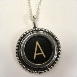 This is a typewriter button, made necklace. <3 i want it.