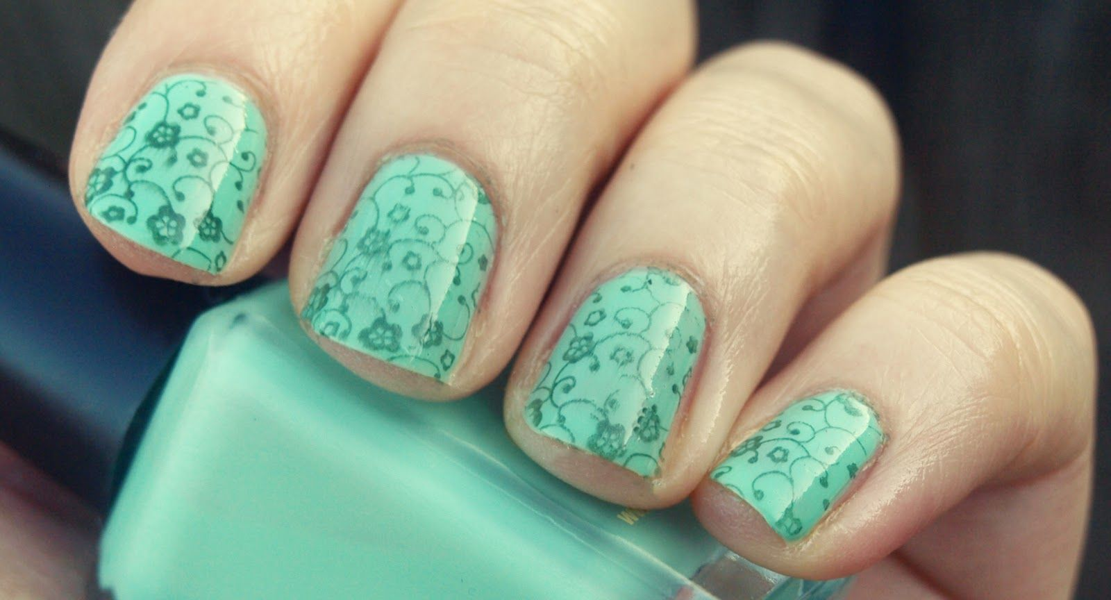 Mint Green nail polish with little flower designs. Totes Adorbs<3 ...