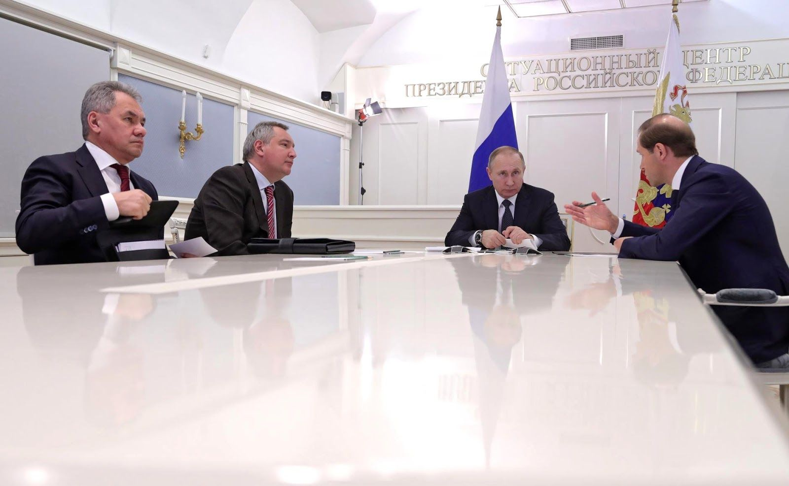 Videoconference with Russian Aircraft Corporation MiG. With Defence Minister Sergei Shoigu (left), Deputy Prime Minister Dmitry Rogozin and Industry and Trade Minister Denis Manturov (right).