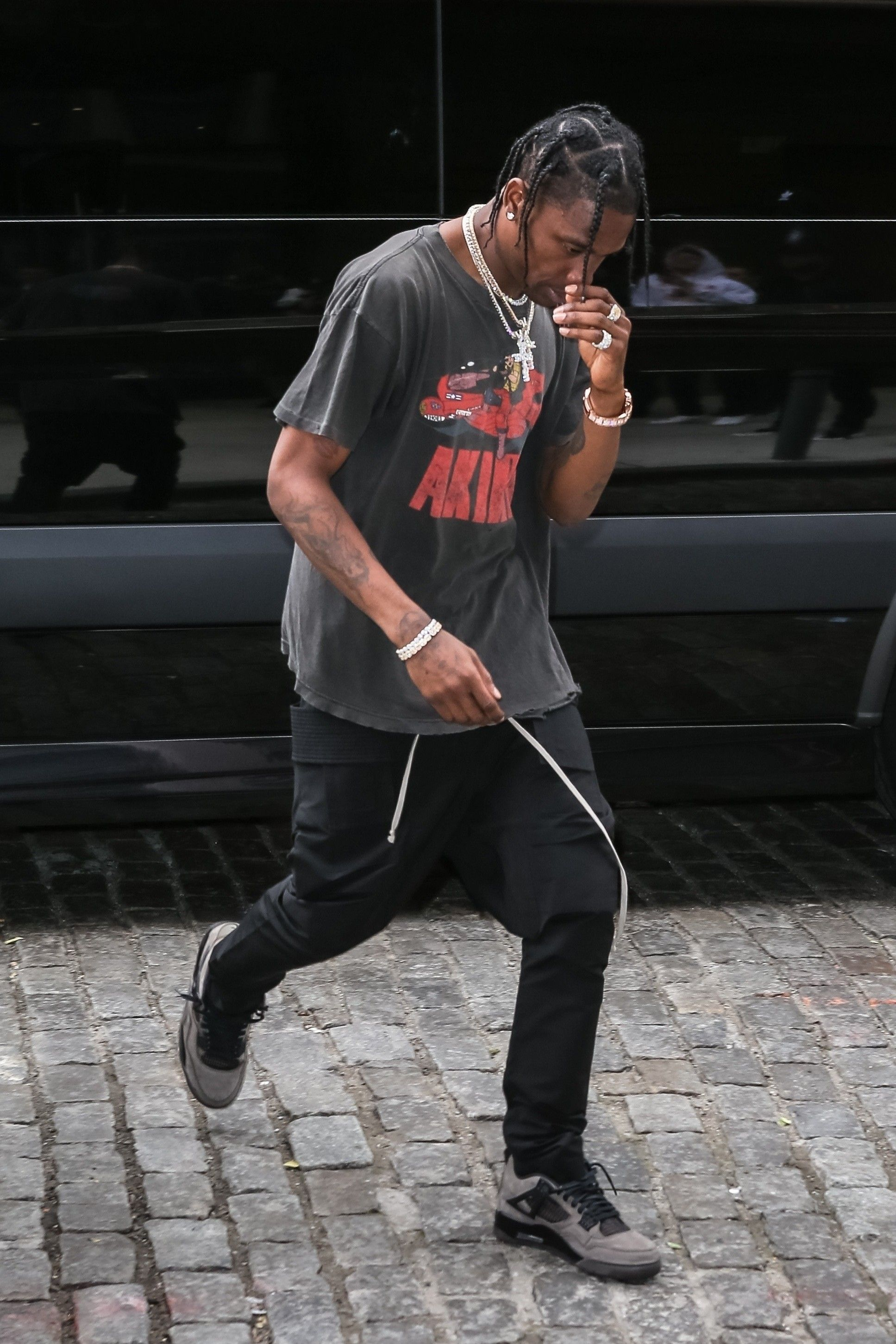 ba09e9a0 Travis Scott wearing Vintage Tees, Rick Owens Pants and Jordan Sneakers