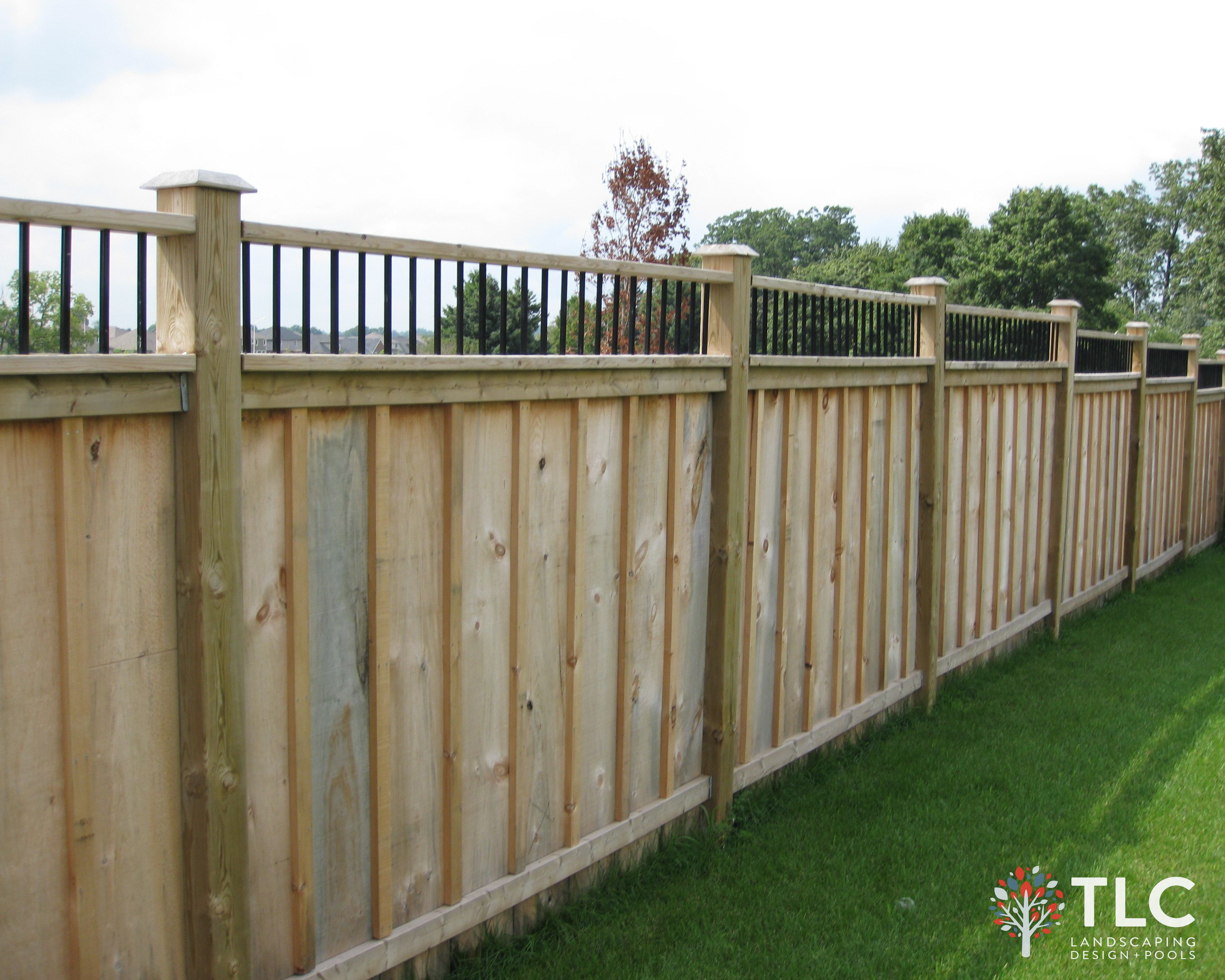 board batten fence with 6x6 posts metal detail top