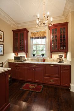 Kitchen With Barn Red Cabinets Br Hardware A Dark Wood Floor And Light Tan Walls Bill Huey Ociates Hueyarchitect