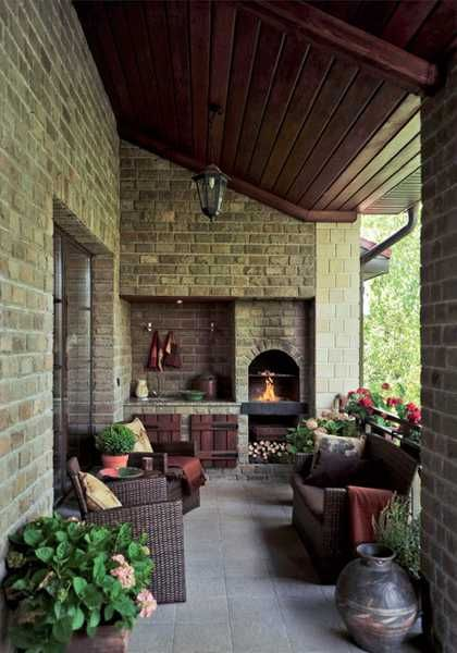 porch decorating with fireplace and seating area