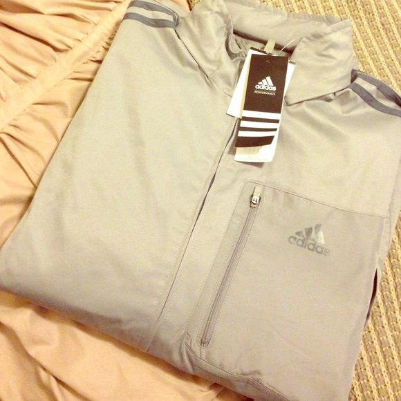 Men's Adidas Windbreaker Brand new with tags attached Men's Adidas Drive 2 Jacket in a light grey with dark grey stripes. Price is negotiable. Adidas Jackets & Coats