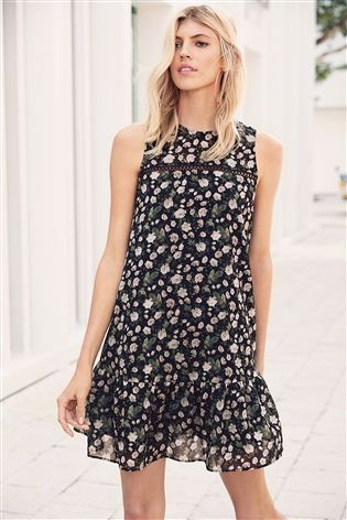 21bc1298a7aa Buy Black Ditsy Floral Frill Hem Swing Dress from the Next UK online shop