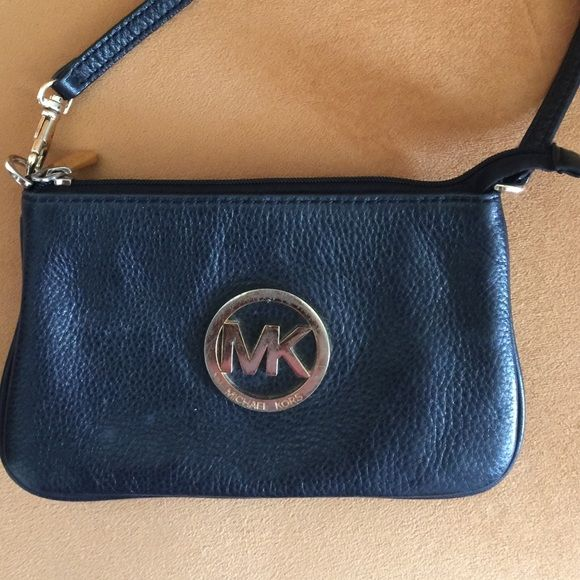 Micheal Kors Wristlet. 100% authentic Fulton black leather with gold medallion pre-owned but in great condition comes from smoke free home. Michael Kors Bags Clutches & Wristlets