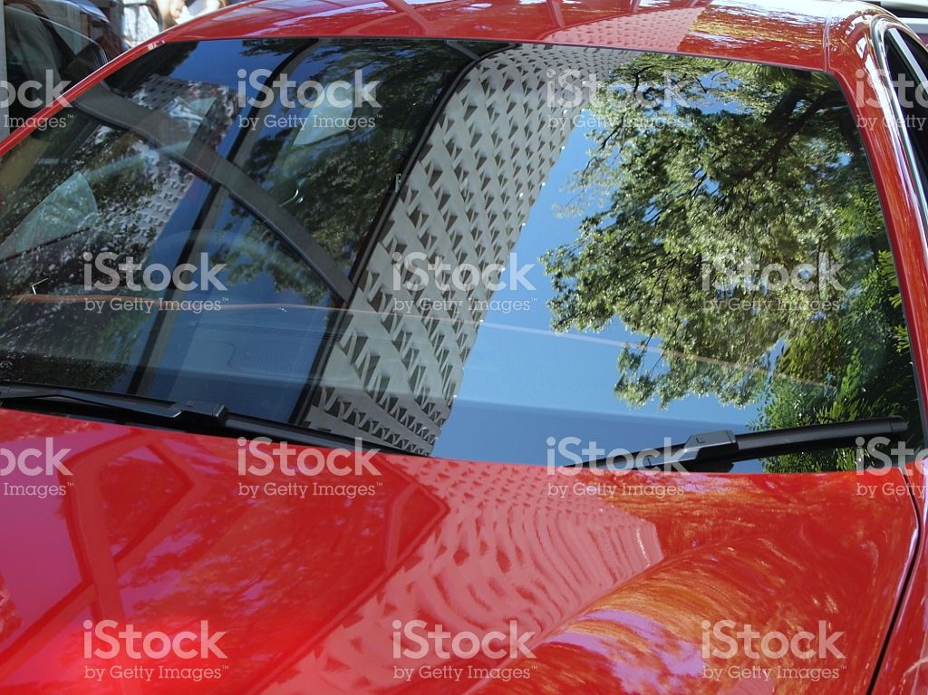 The reflection in a red car