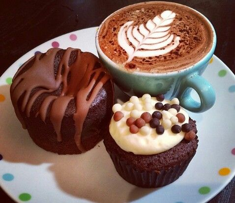 Chocolate cupcakes and coffee latte perfect for breakfast