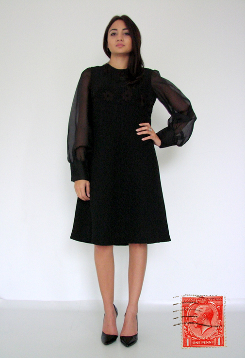 """Elegant midi 'A' line dress with long loose semi-transparent sleeves finished with wide 3 material covered buttoned cuffs. In the upper body, the dress has a gorgeous embroidery of brown flowers and black leaves and small """"embroidered knots"""" adding to the texture. Zip closure at back and with a satin lining. Label says """"Vogue, Pzza Buenos Aires, 7, Rome """". The material is very good, ideal for autumn / winter and even spring. vintagehunters.eu"""