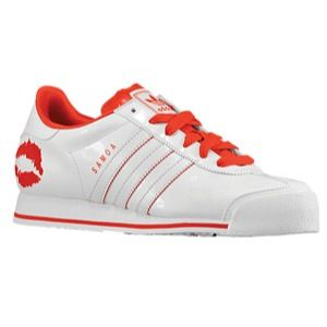 Red and white adidas samoas with red lips on the back