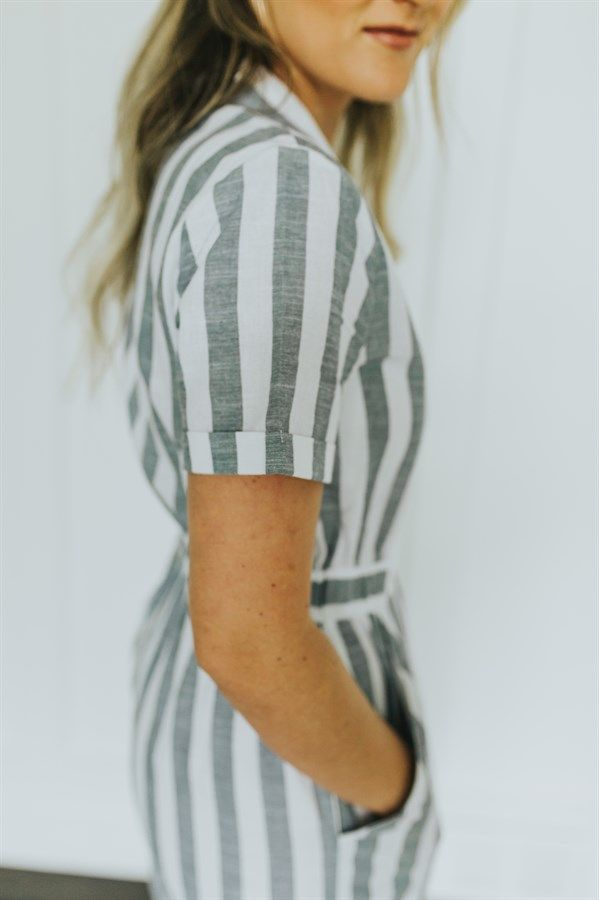 We are loving this striped pencil dress and all the amazing little details!  Zips down the front making it nursing friendly! Elastic waist band and front slit.