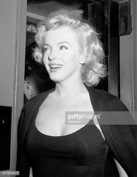 Marilyn Monroe during press conference in corridor of her hotel.