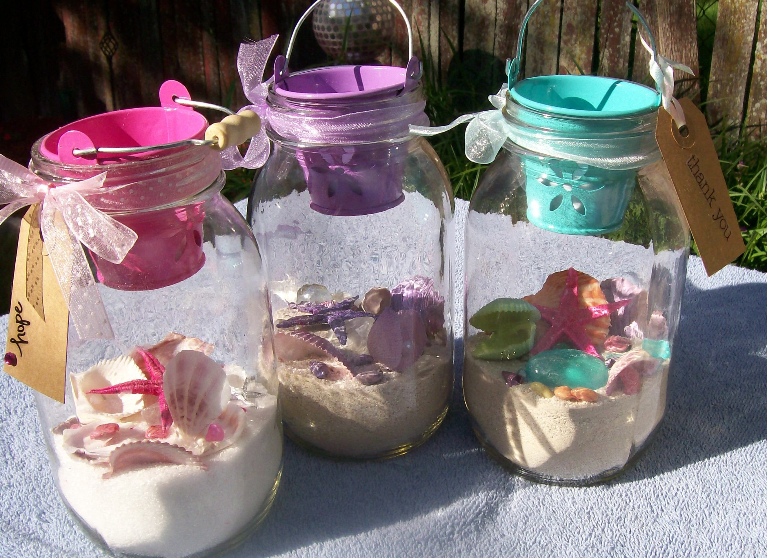 More little homemade sea shell jars for beach themed party