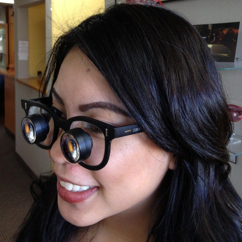 Girl with thick glasses