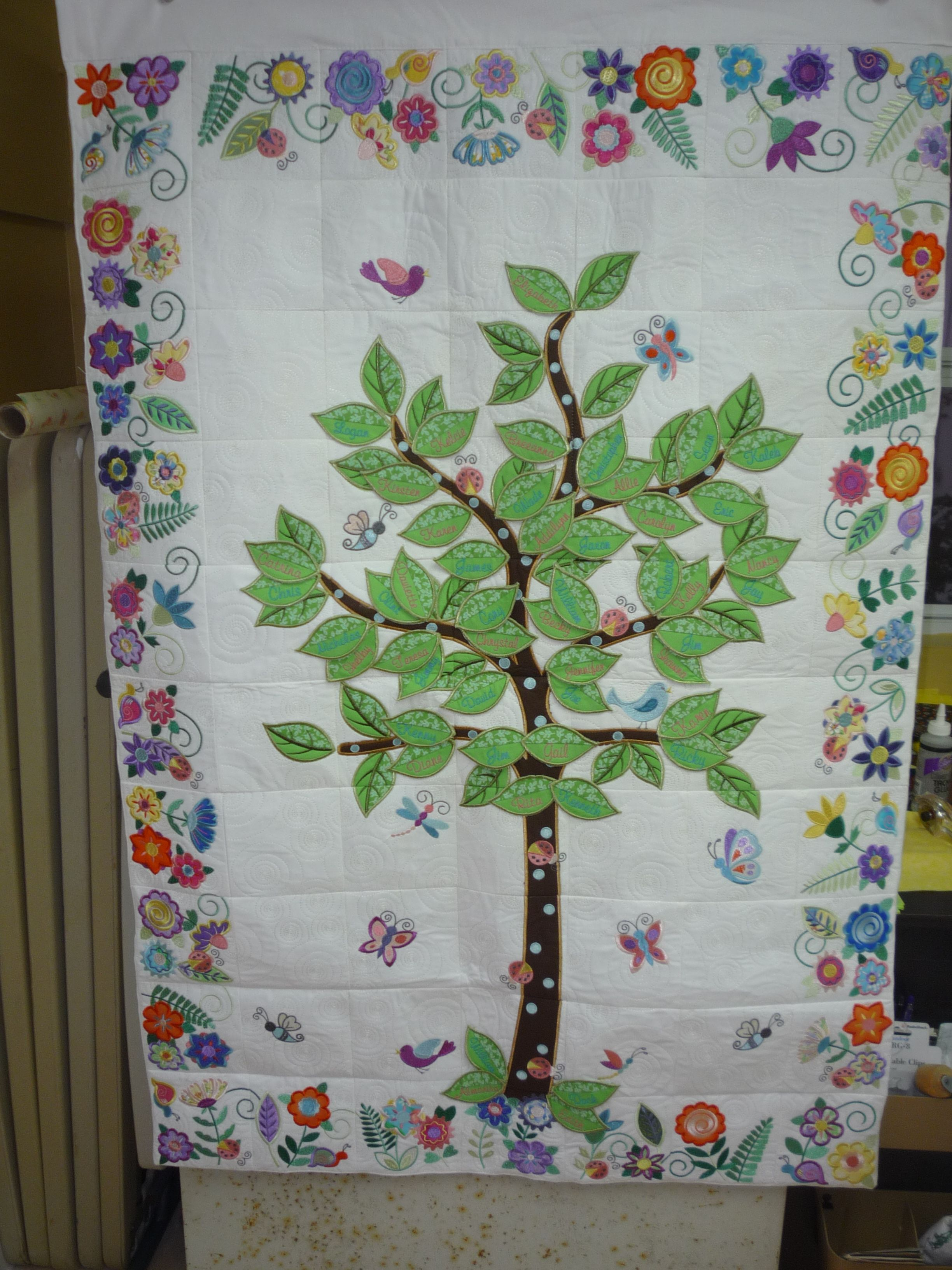 Life quilt includes names of family members on the tree leaves.