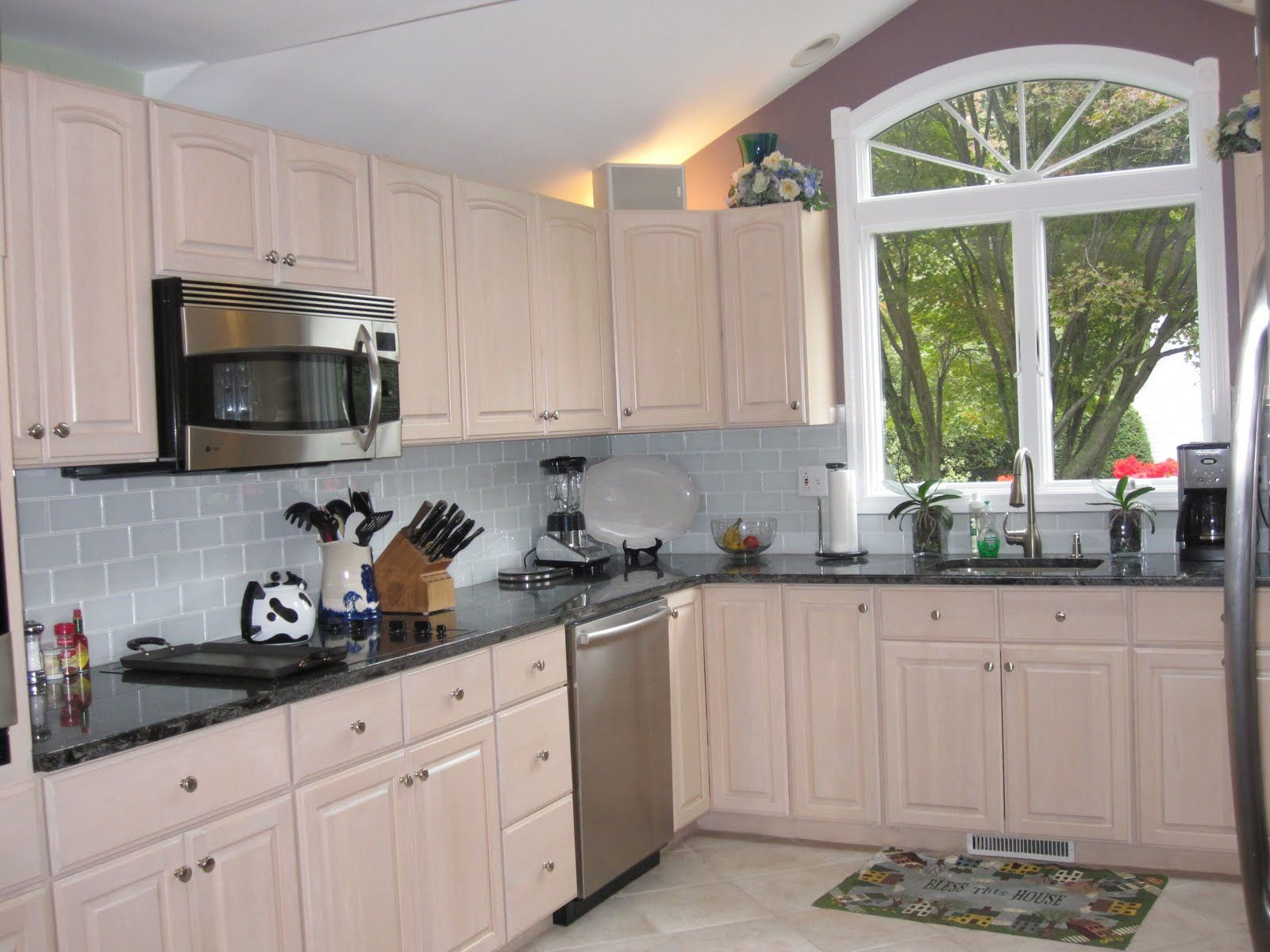 The Dark Granite Is Nice With The Pickled Cabinets.