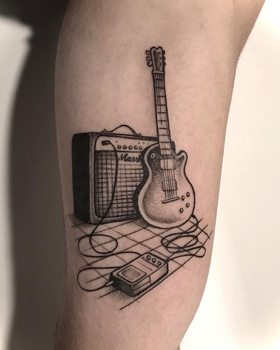 15 Best Guitar Tattoo Designs With Meanings For Girls Guys Guitar Tattoo Design Guitar Tattoo Tattoo Designs