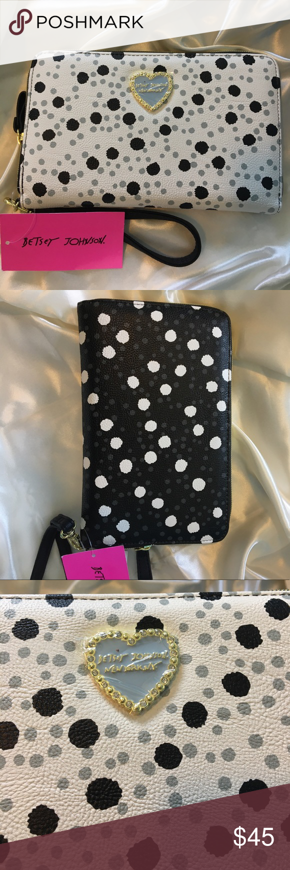 💥NWT Betsey Johnson Dots Travel Wallet! BRAND NEW with tag Betsey Johnson Dots Travel Wallet! Perfect to hold everything! Has 12 card slots and a zipper divider. Dot prints is in color black and gray and has a gold zip top closure. Will ship immediately, get her now❤️ Betsey Johnson Bags Wallets