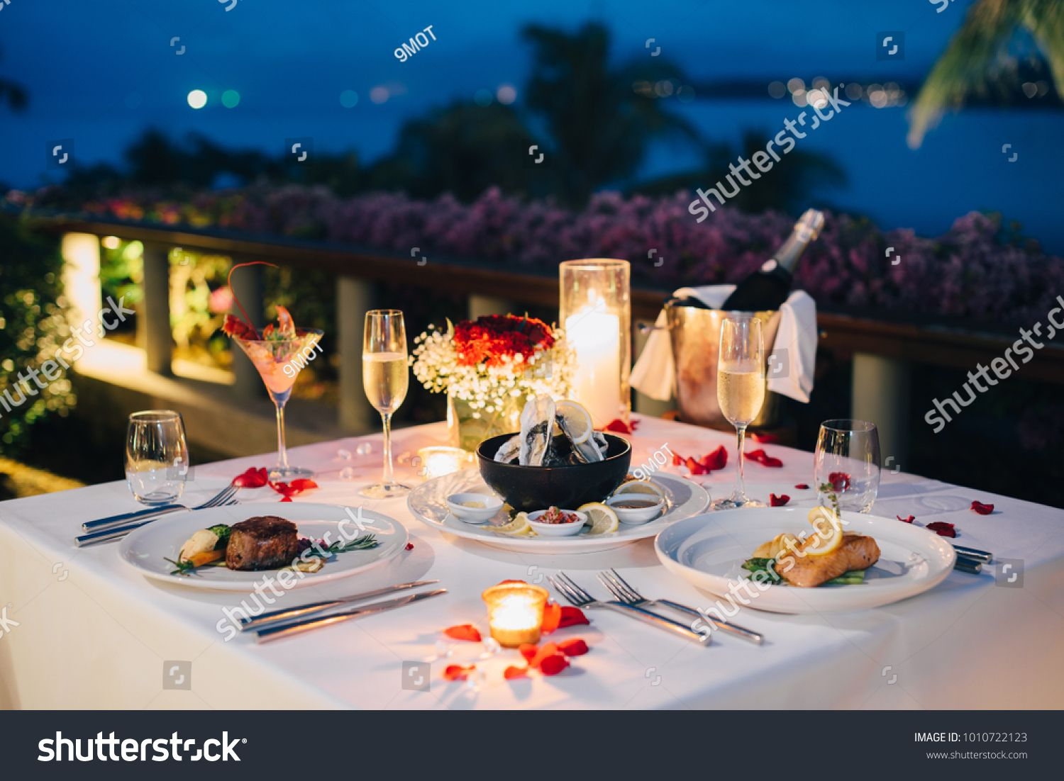 Luxury Romantic Candlelight Dinner Table Setup For Couple In Ocean View Restaurant O In 2020 Candle Light Dinner Romantic Candle Light Dinner Candle Light Dinner Ideas