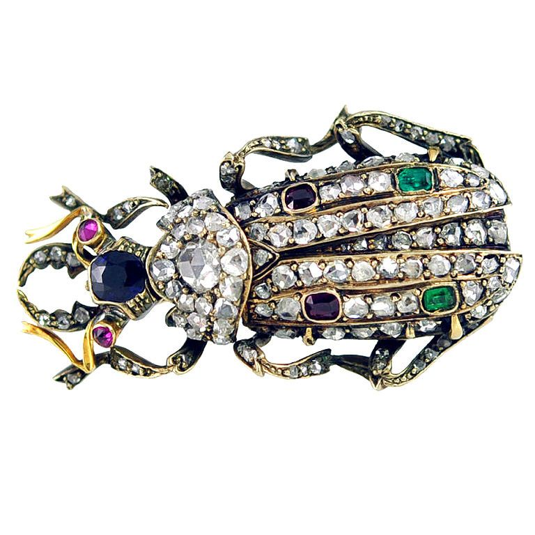 1900.  Platinum and gold beetle with rose cut diamonds, ruby eyes, sapphire, emeralds and rubies.
