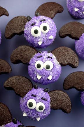 Miniature bat cookie wings for cupcakes. I was looking all over for this. She uses her homemade oreo cookie recipe to make these out of half moon cookie cutters. I'm making these for Halloween.