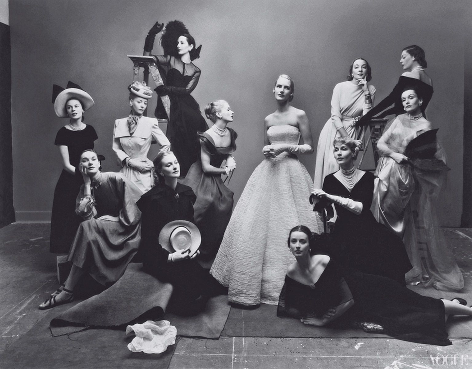 """Vogue, May 1, 1947  One of Irving Penn\'s most famous tableaux, often referred to as \""""The Twelve Beauties.\"""" At this sitting Penn first fell in love with wife-to-be Lisa Fonssagrives, sixth from left."""