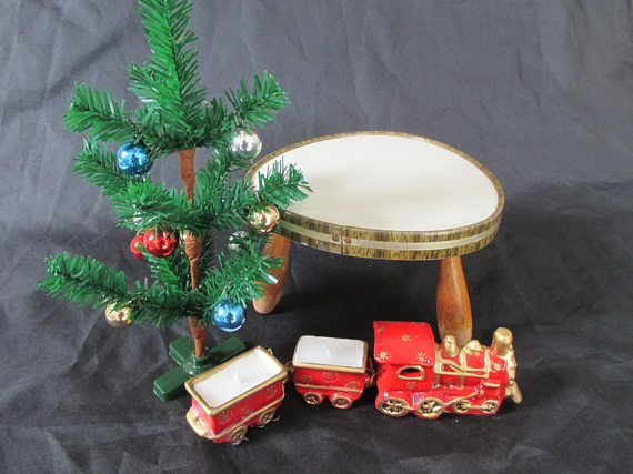 This fun Midcentury era plant stand would make a perfect Christmas