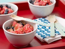 Red, White and Blue Fruit Salad : Great for a summer picnic or packed in a lunch, this colorful fruit salad has a tropical touch, thanks to the ginger, lime and toasted coconut.