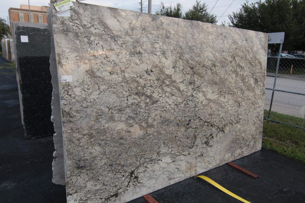 Beautiful Cream Based Granite Specks Of Blue And Grey Along With