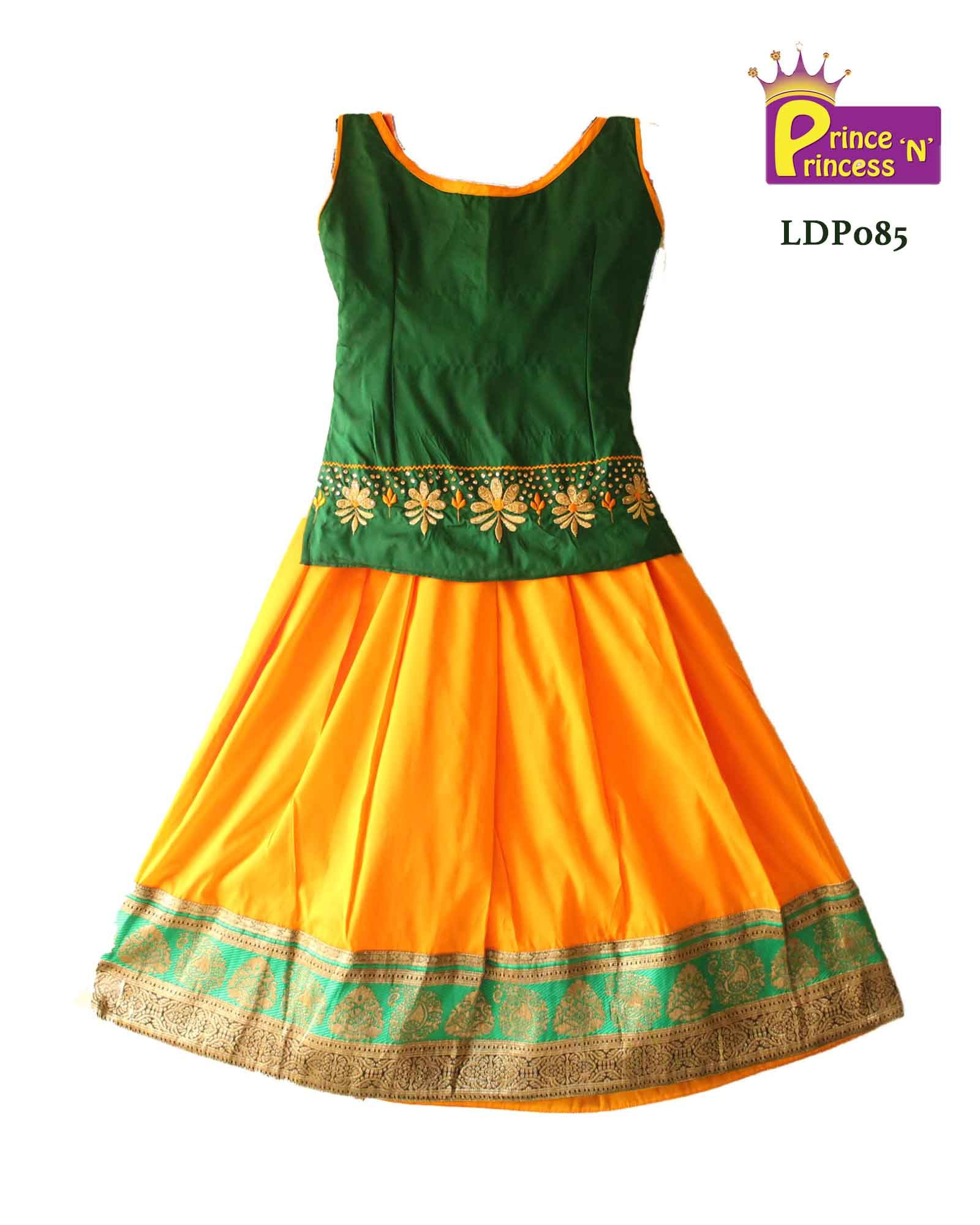 Beautiful green orange boad neck pattu pavadai with embroidery and