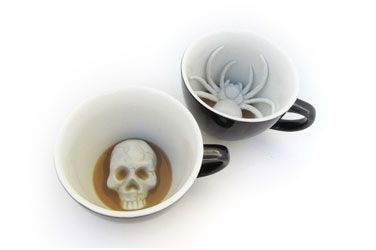 How creepy cool is it to find a spider or skull at the bottom of your drink?  If the coffee does not wake you these creepers certainly will!  Black cups with white creature interior.  Dishwasher safe and microwavable.   Capacity: 11 oz