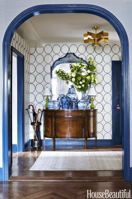 A dramatic blue and white foyer with a collection of blue and white Chinese porcelain - the woodwork is in Benjamin Moore Twilight