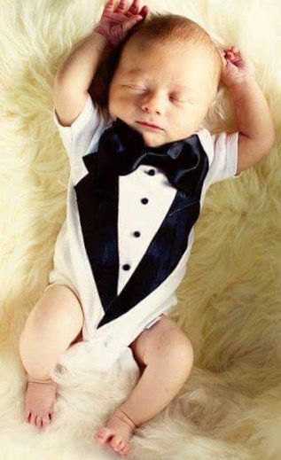 abb6a668b2a8 Baby wearing a tuxedo outfit