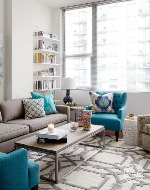 teal living room chair rooms to go a bold rental friendly redesign in chicago new apt ideas turquoise decor grey and blue accent peacock