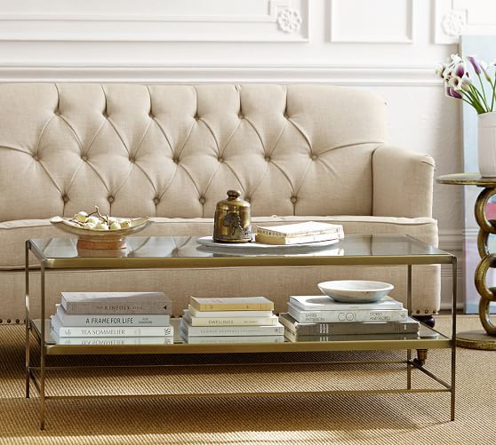 Like A Showcase For Collectibles, The Glass Topped Leona Coffee Table With  A Mirrored Shelf Makes A Noteworthy Display Of Every Item It Holds.