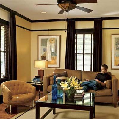 Homeowner Reading On A Couch In His Remodeled Bungalowu0027s Living Room