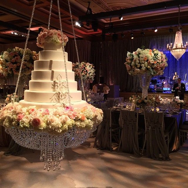 Nisie Vorachard On Instagram Our Signature Hanging Cake Accompanying 7 Layers Of Beauty By The Suspended Wedding Cake Wedding Cake Stands Wedding Cake Table